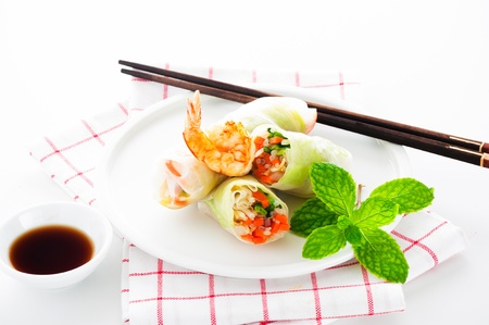 soy sprouts: Vegetarian spring roll with carrot, soy sprouts and shrimp on white background as a studio shot Stock Photo