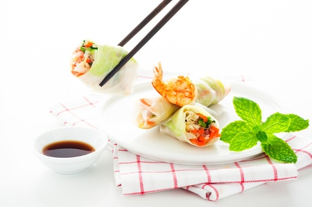 Vegetarian spring roll with carrot, soy sprouts and shrimp on white background as a studio shot Stock Photo - 12784612