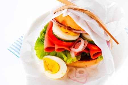 Baked garlic ciabatta sandwich with fresh salad tomato onion egg and sausage as supplement Stock Photo - 13663273