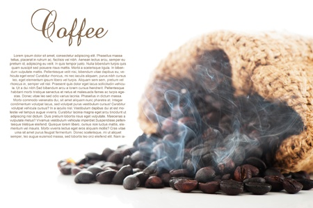 Steaming hot coffee beans in a bag on white background as a studio shot with area for your text photo
