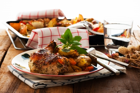 baked chicken: Baked chicken thighs with vegetables on a plate