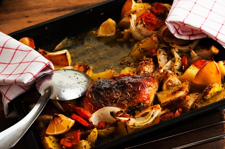 aked chicken thighs with vegetables on a baking tray Stock Photo - 14039178