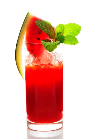 sliced watermelon: Watermelon smoothie garnished with watermelon slices and mint leaves isolated on white Stock Photo
