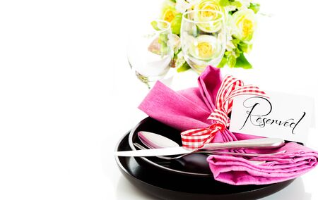 Dinner set with pink napkin and reservation card on white background as a studio shot Stock Photo - 14404443