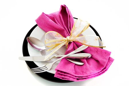 Dinner set with pink napkin on white background as a studio shot photo