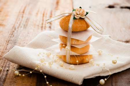 Vanilla cookies as present on napkin and wooden table photo