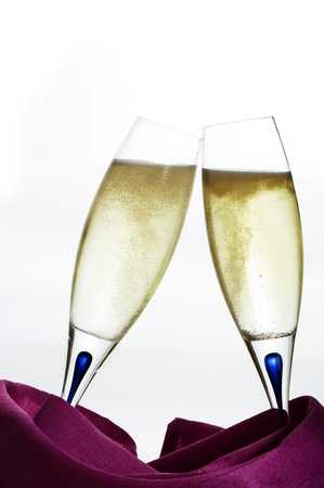 Two glasses of champagne on white background photo