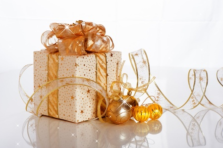 Christmas gift box with decoration on white background photo