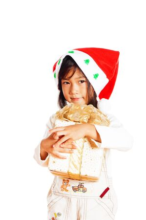 Happy little girle with Christmas gift isolated on white background Stock Photo - 15041067