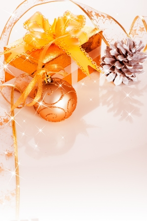 Christmas gift box with decoration on white background