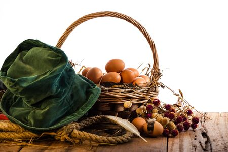 Basket of eggs on a wood table Stock Photo - 15888851