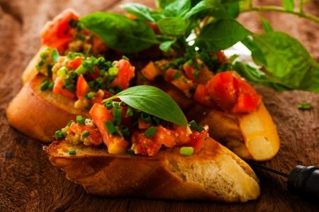 delicious bruschetta appetizer on wooden board photo