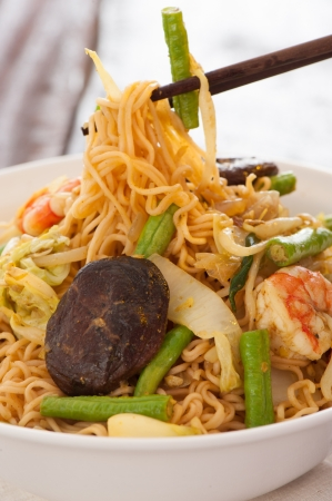 egg noodles: Spicy asian curry noodles with vegetables shrimps and china mushrooms on wooden table