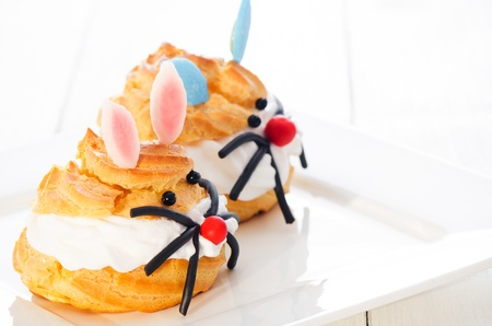 two cream puff decorated as girl bunny and boy bunny photo