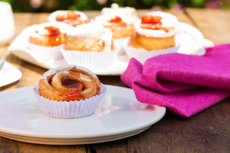 small cake with strawberry jam on white plate Stock Photo - 24512681
