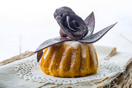 Moist flower cake topped with delicate chocolate fondant photo