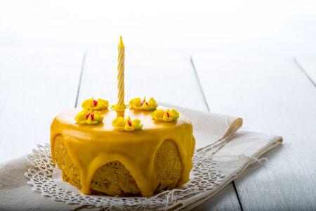 birthday cake, yellow glazed cake, designed cake photo