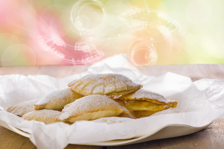 mouth watering: Close up Delicious Cookies with Sugar on Plate with White Paper, Placed on Wooden Table. Stock Photo