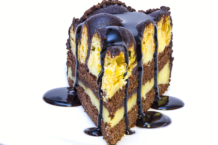 cake pick: a piece of isolated vanilla and chocolate cake with chocolate sauce