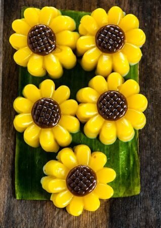 gelatin: Yellow jelly dessert looking like a flower made with coconuts and pumpkin