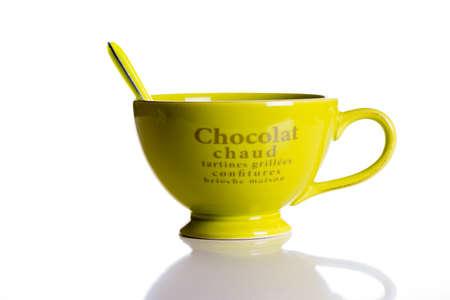 jumbo: Green jumbo chocolate mug with spoon isolated on white background