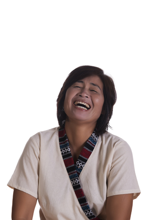 laughing out loud: Single beautiful Asian middle aged woman in short sleeve shirt laughing out loud with eyes closed over white