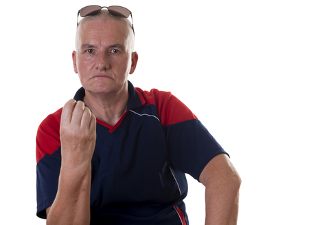 balding: Annoyed single older balding man with sunglasses on top of head and hand up near chin over white background