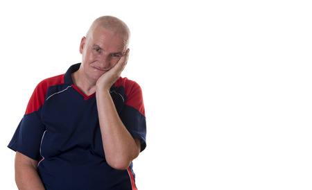 shaved head: Upset or embarrassed single older man with shaved head and palm of hand on cheek and ear over white background Stock Photo