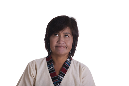 vexation: Front view on single Asian frustrated woman rolling her eyes upwards with frown over white background