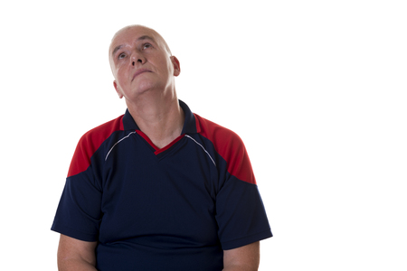 short sleeve: Front view of bored older man in blue and red short sleeve shirt looking up over white background