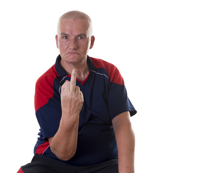 shaved head: Single angry man dressed in blue and red short sleeve shirt with shaved head sticking up middle finger from his hand over white background Stock Photo