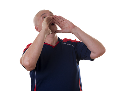 balding: Side view of single middle aged balding man in red and blue shirt holding both hands around mouth calling out or yelling over white background Stock Photo