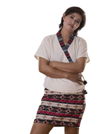 the thoughtful: Thoughtful pretty woman with dark hair and wearing colorful skirt leans head to one side Stock Photo