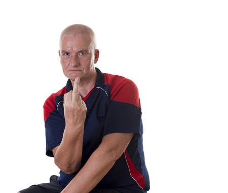shaved head: Single upset man dressed in blue and red short sleeve shirt with shaved head sticking up middle finger from his hand over white background Stock Photo