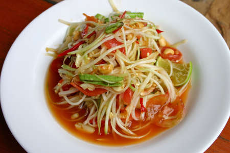 Hot and spicy papaya salad photo