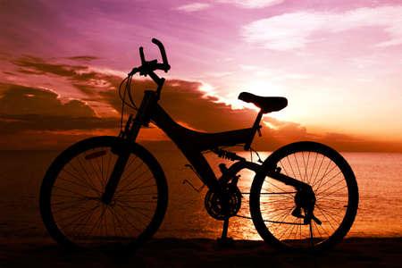 Silhouette of a Bike on the Beach photo
