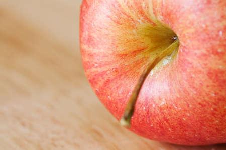 Apple on rustic wood background photo