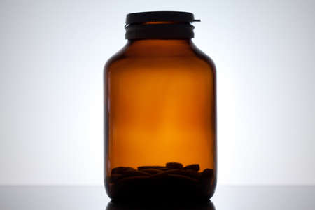 Close up on a medicine bottle photo