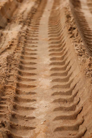 off path: Tire Tracks in the Sand