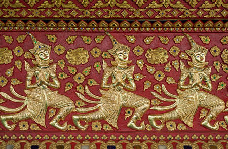 Thai style gloden deva carving on wood photo