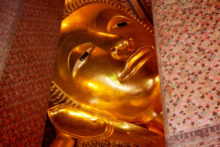 Reclining Buddha statue in Wat Pho in Bangkok photo