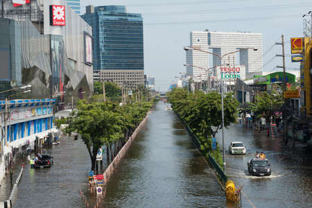 Bangkok, Thailand - November 6, 2011 - Cars navigate through the flood on Phahonyothin Road