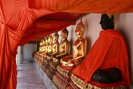 Row of sitting Buddha statues in Buddhist temple (Wat Pho), Thailand