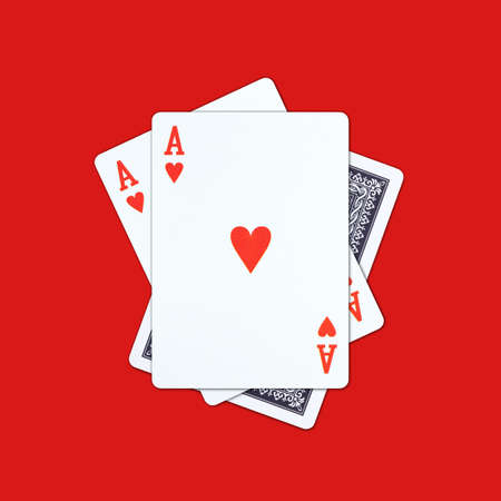 Ace playing cards on red background