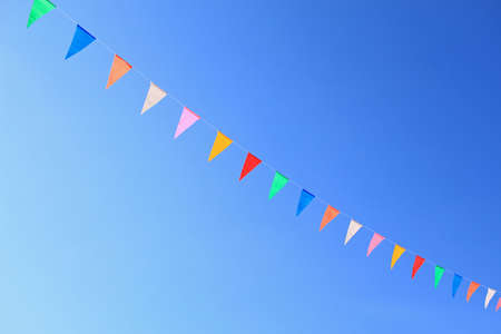 Colorful paper flag with blue sky
