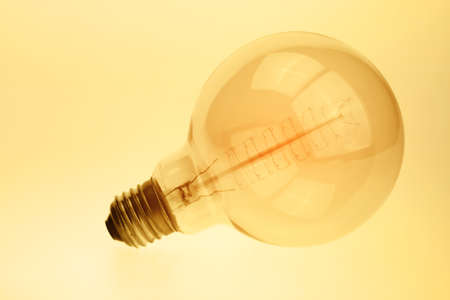 Close up vintage glowing light bulb Stock Photo