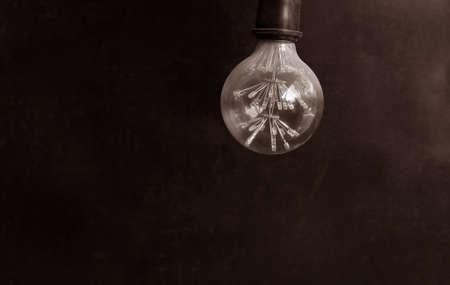 Energy saving LED light bulb on a dark background Фото со стока