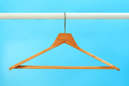 Cloth hangers in row Stock Photo