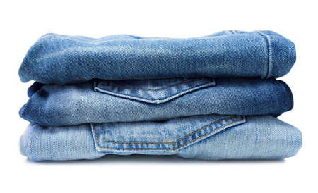 Stack of blue jeans isolated on white Stock Photo