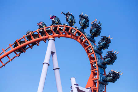 Rollercoaster ride with blue sky